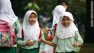 Muslim schoolgirls walk in headdresses in Jakarta, Indonesia, in March 2009.