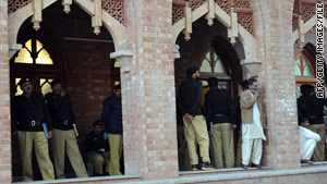 Pakistani police stand guard last week outside a Lahore court handling the case of five detained Americans.