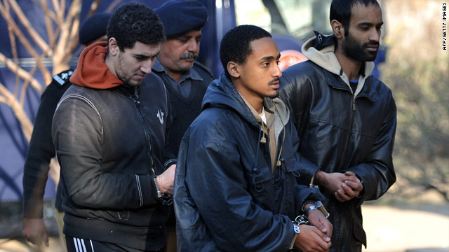 Some of the American detainees are escorted into court by Pakistani police on Friday.