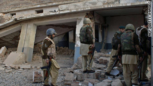 Pakistani troops inspect a girls' school building destroyed by Taliban militants earlier this month.