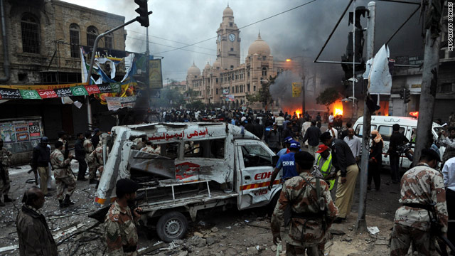 Security officials inspect the blast site in Karachi.