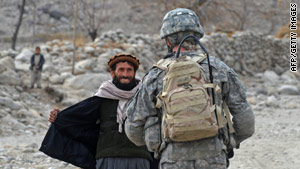 A U.S. soldier checks an Afghan man for weapons in Nuristan province on Sunday.