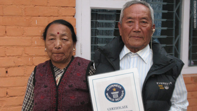 Min Bahadur Sherchan with his Guinness certificate recognizing the climb and his wife Purna Kumari.