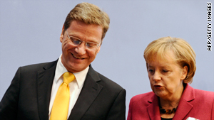 German Chancellor Angela Merkel and Guido Westerwelle, Germany's new foreign minister, present their coalition government programme in Berlin