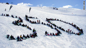 The Wanaka Wastebusters gather at a local ski mountain in New Zealand to call for 350 to protect their snow.