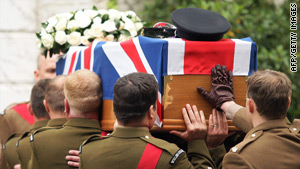 A casket containing the body of Lt. Col. Rupert Thorneloe is carried at his funeral in July, 2009.