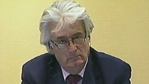 Radovan Karadzic appears at a hearing on Tuesday to discuss his refusal to appear at the trial.