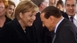 Silvio Berlusconi with German Chancellor Angela Merkel at a recent meeting in Berlin.