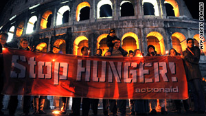 Anti-hunger campaigners demonstrate at the Colosseum in Rome on Sunday ahead of the world food security summit.