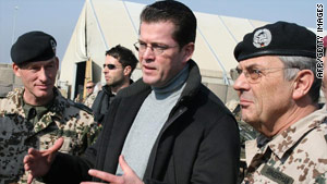 German Defense Minister Karl-Theodor zu Guttenberg (center) speaks with German soldiers in Kunduz last week.