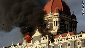 Smoke billows out of the Taj Majal hotel in Mumbai, India, during a siege in November 2008.