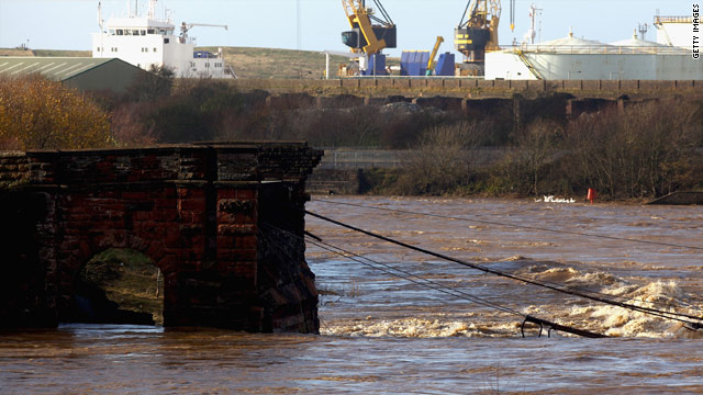 The remains of a bridge in Workington, England  where a police officer was swept away to his death when it collapsed.