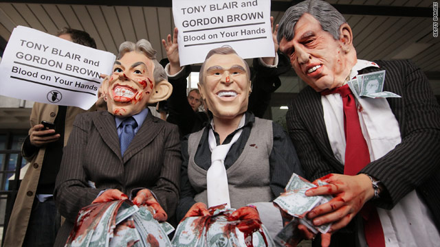 Anti-war demonstrators pose in masks and fake blood outside the UK Iraq war Inquiry, November 24, 2009.