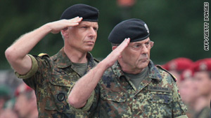 Schneiderhahn, right, inspects troops bound for Afghanistan in June 2008.