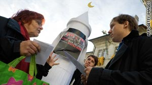 A passer-by argues with politicians carring a mockup of a minaret at a protest against the referendum in Lausanne.