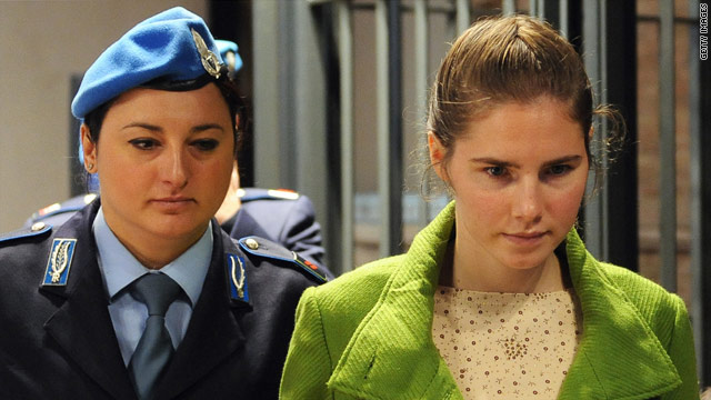 Amanda Knox is escorted during her murder trial in Perugia, Italy, on Thursday.