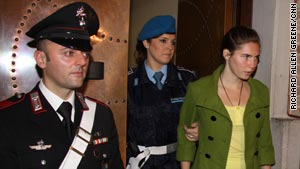 Amanda Knox is led into the court in Perugia Friday, on what is expected to be the last day of her trial.