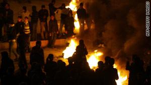Kurdish demonstrators clash with police Friday in front of the Pro-Kurdish Democratic Society Party in Diyarbakir, Turkey.