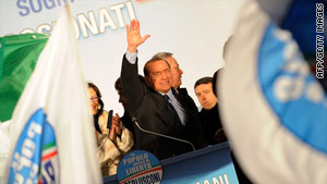 Silvio Berlusconi waves to supporters at a party rally in Milan Sunday before he was attacked.