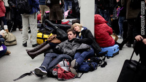 Stranded passengers wait at a London terminal Saturday after a series of train breakdowns inside the Channel Tunnel.