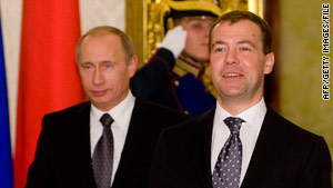Russian Prime Minister Vladimir Putin, left, and President Dmitry Medvedev favor more offensive nuclear missiles.
