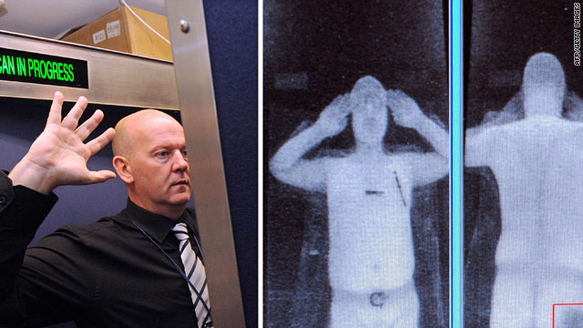 A staff member demonstrates a full body scan at Manchester Airport in the UK.