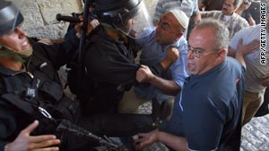 Israeli police scuffle with Palestinian men in Jerusalem's old city.