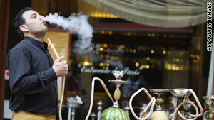 A Lebanese waiter prepares a waterpipe for a client at a restaurant in Beirut. Health professionals say the number of smokers in Lebanon is among the highest in the region.