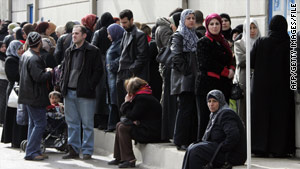 Iraqis wait outside the United Nations High Commissioner for Refugees office in Duma, Syria, on February 13, 2008.