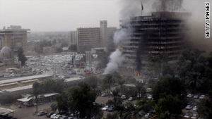 Two car bombs killed scores of people outside Iraqi government buildings in Baghdad.