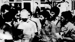 Iranian students with a blindfolded hostage after the U.S. Embassy in Tehran was overrun on November 4, 1979.