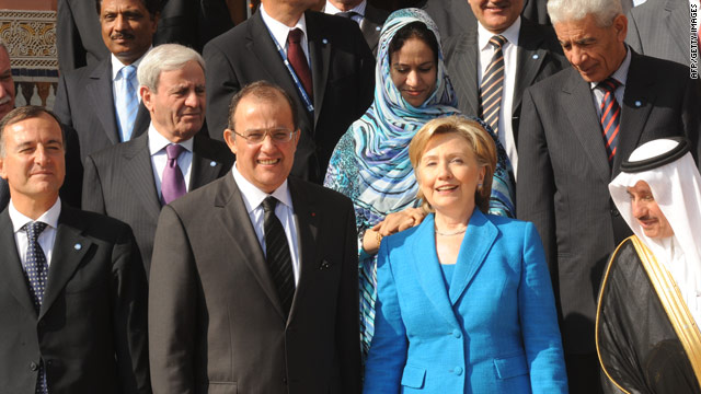 Secretary of State Hillary Clinton poses with other leaders attending the Forum for the Future in Morocco on Tuesday.