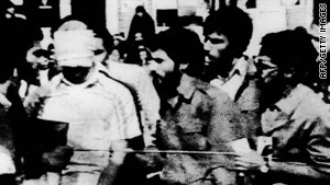 A blindfolded American hostage is surrounded by his captors in Tehran, Iran, on November 8, 1979.