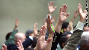 A show of hands takes place during the first session of the Kurdish parliament in Arbil.