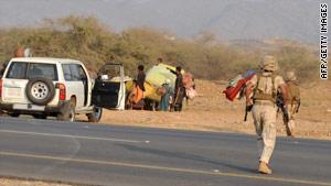 Saudi soldiers surround suspected Yemeni infiltrators near the Yemen border on November 7.