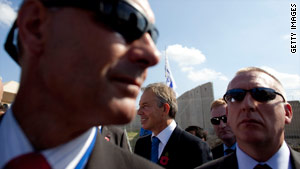 Tony Blair (center) surrounded by bodyguards at the opening Tuesday of a crossing between Israel and the West Bank.