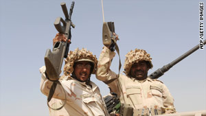 Saudi soldiers head toward the border with Yemen on Monday.