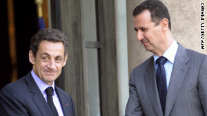 Syrian President Bashar al-Assad (right) shakes hands with French President Nicolas Sarkozy at the Elysee palace.