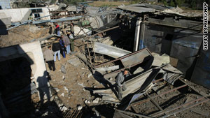 Palestinians check the damage caused by an Israeli airstrike on smuggling tunnels in Gaza on Sunday.