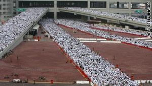 Muslim pilgrims cross the new bridge to perform the annual ritual of the stoning of Satan in Mina.