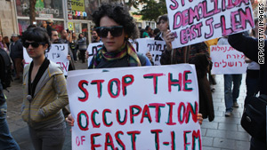 Israeli left wing activists hold placards during a rally in downtown Jerusalem.