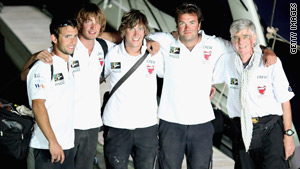 The five British sailors arrive at a Yacht club in Dubai Wednesday after being detained in Iran since November 25.
