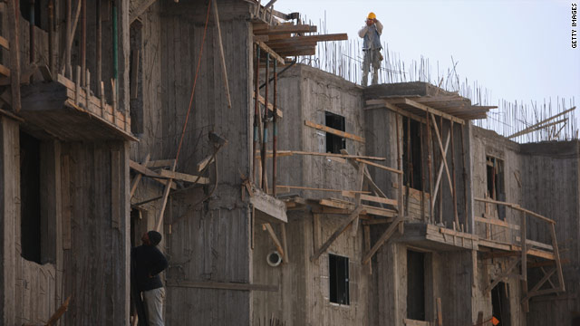 Palestinian laborers work on a new housing project on December 2, 2009 in a Jewish settlement in the West Bank.