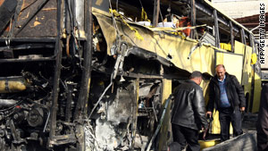 Police officers inspect the damaged bus in Damascus on Thursday.
