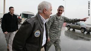 Defense Secretary Robert Gates walks with Lt. Gen. Kenneth Hunzeker on Thursday at Baghdad International Airport