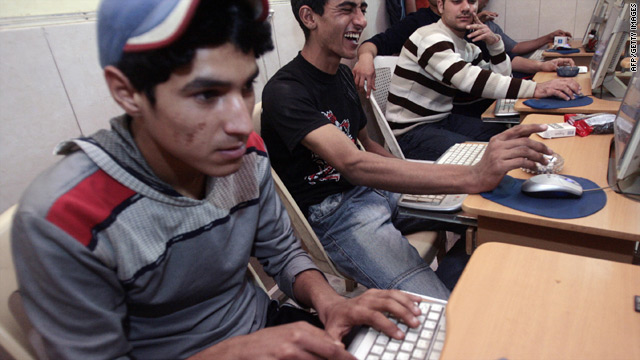 Iraqi youths access the Internet at a cafe in Baghdad.