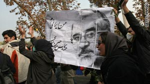 Iranian opposition supporters hold a picture of Mir Hossein Mousavi during an anti-government demonstration.