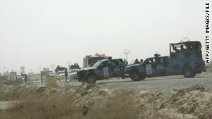 Iraqi police vehicles block the entrance to Camp Ashraf during a skirmish in July.