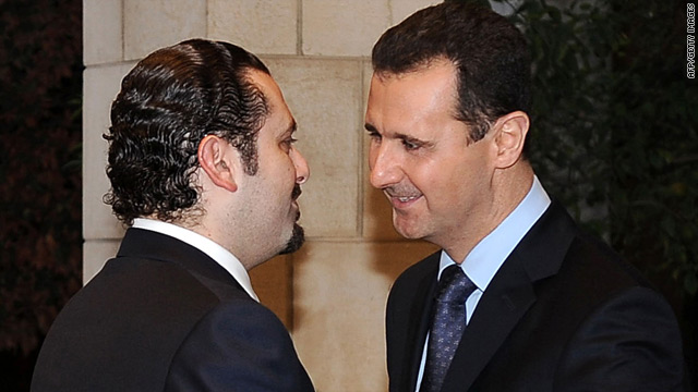 Syrian President Bashar Assad greets Lebanese Prime Minister Saad Hariri (left) on his arrival in Damascus.