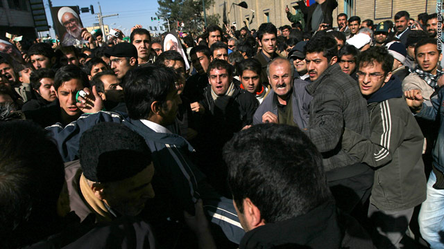 Anti-government protesters confront pro-government protesters Monday in Qom during the funeral of Grand Ayatollah Hussein Ali Montazeri.